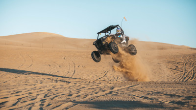 With ATV on the the sand dunes