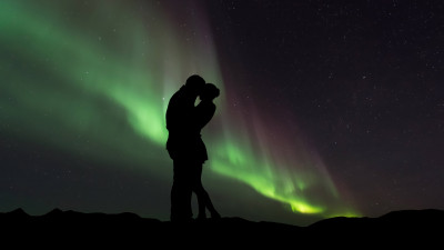 Couple in love under the Northern Lights