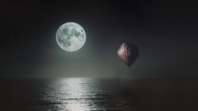 Hot air balloon over the night sky