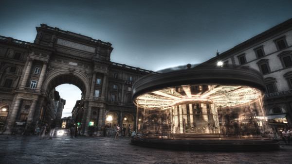 Carousel, people and buildings from Florence
