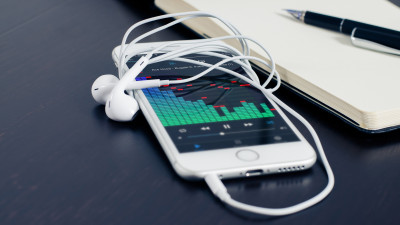 Music plays on the iPhone's earphones