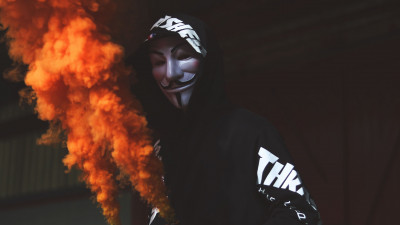 Anonymous mask and orange smoke