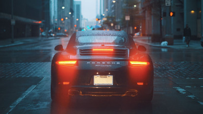 Porsche 911 Carrera on rainy streets