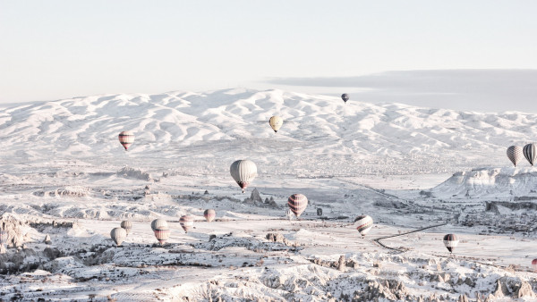 Hot air balloons in Winter landscape