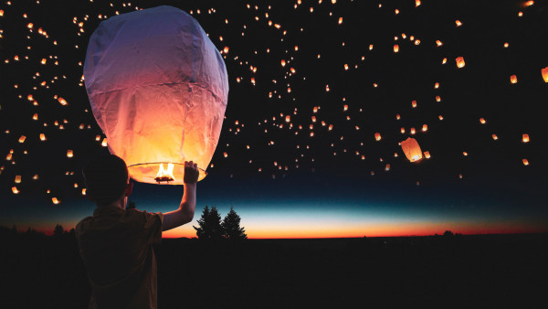 Lanterns floating on the night sky