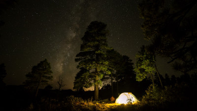 With tent under the night sky