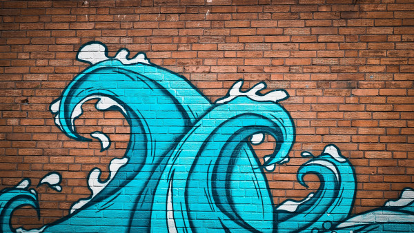 Graffiti waves on brick wall
