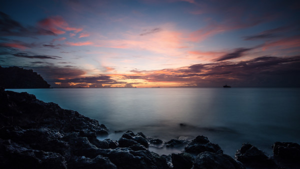 Sunset, rocks, clouds, view from Thailand