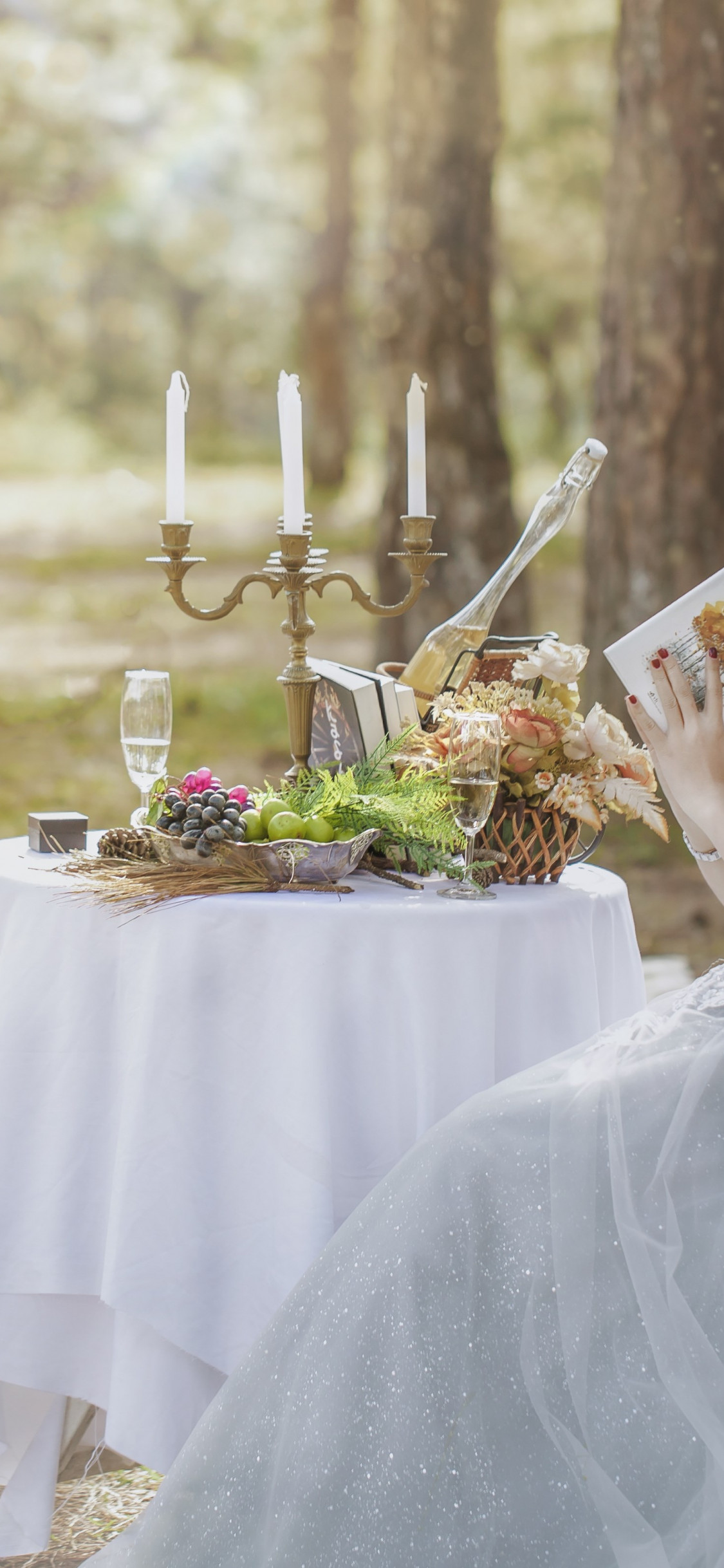 Bride in wedding outdoor scenery | 1125x2436 wallpaper