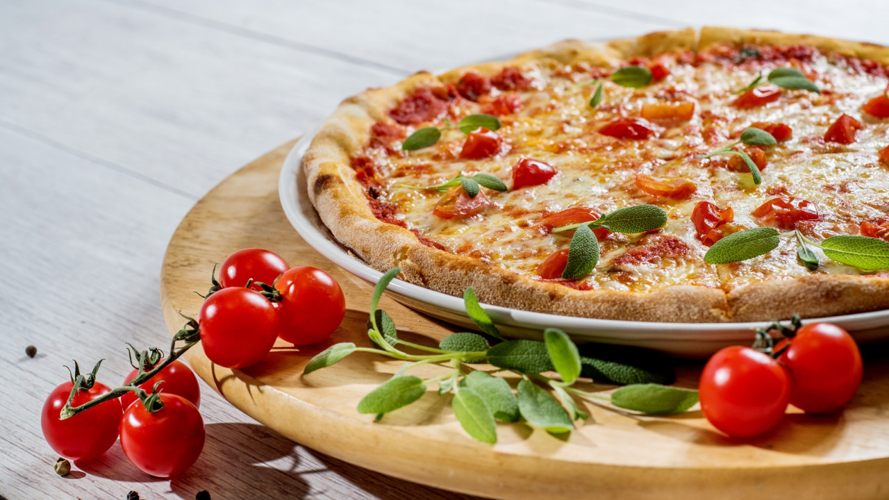 Pizza with cheese and tomatoes wallpaper 1280x720