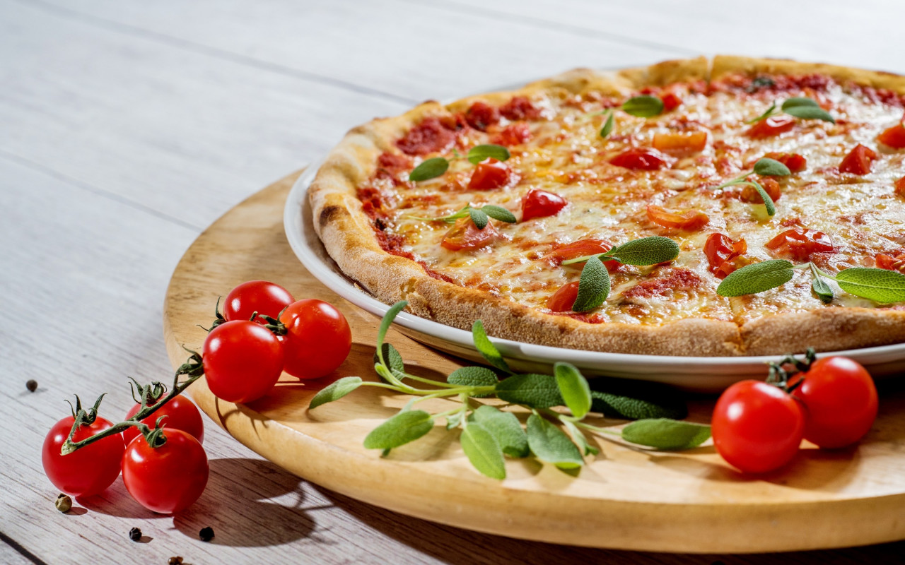 Pizza with cheese and tomatoes wallpaper 1280x800