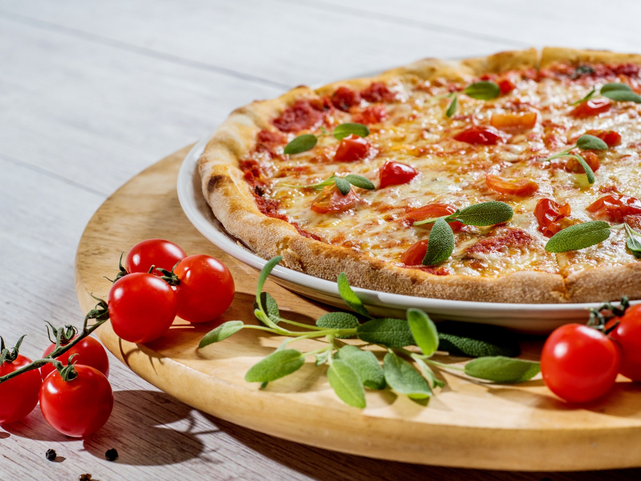 Pizza with cheese and tomatoes wallpaper 1280x960