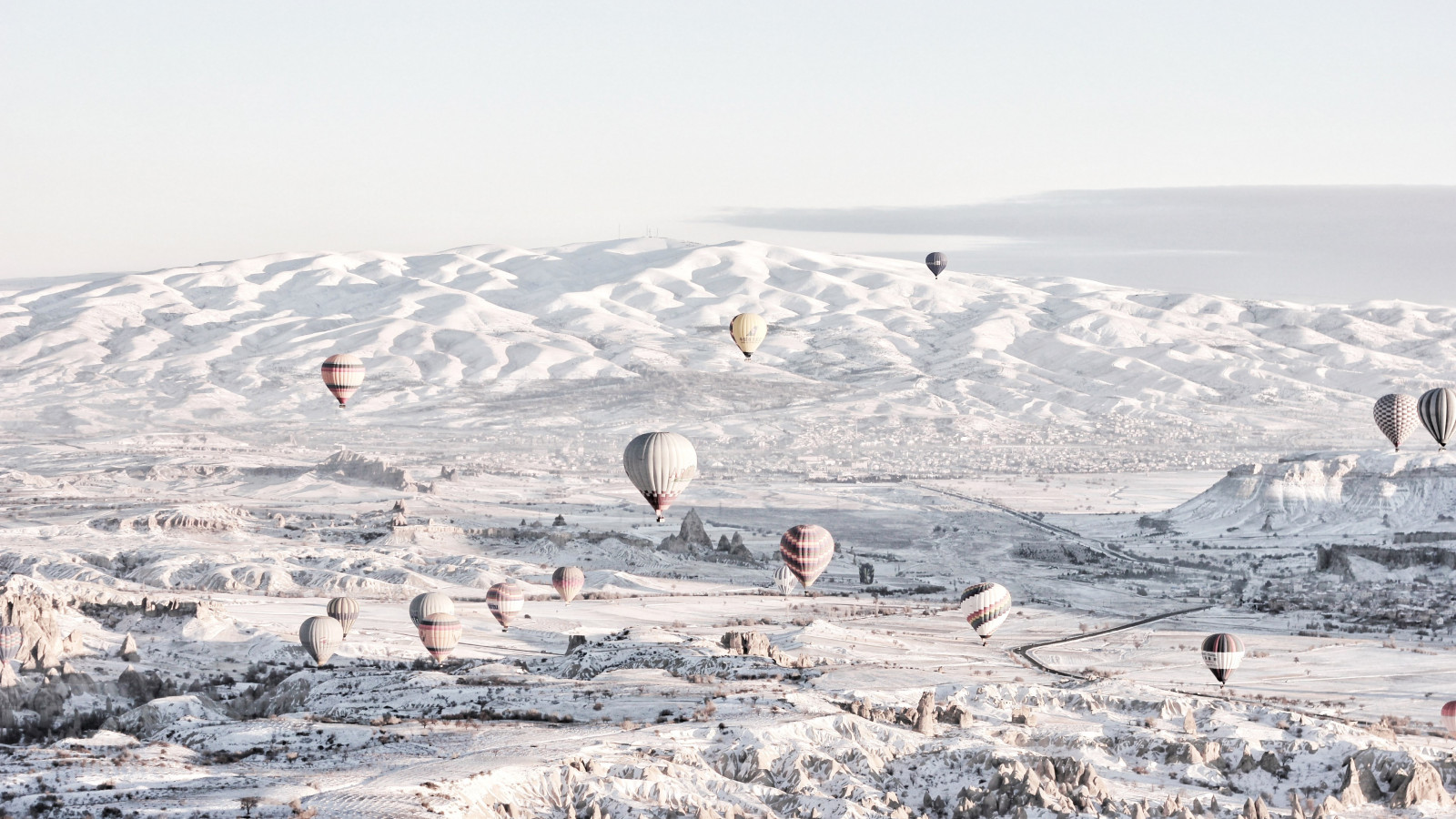 Hot air balloons in Winter landscape wallpaper 1600x900