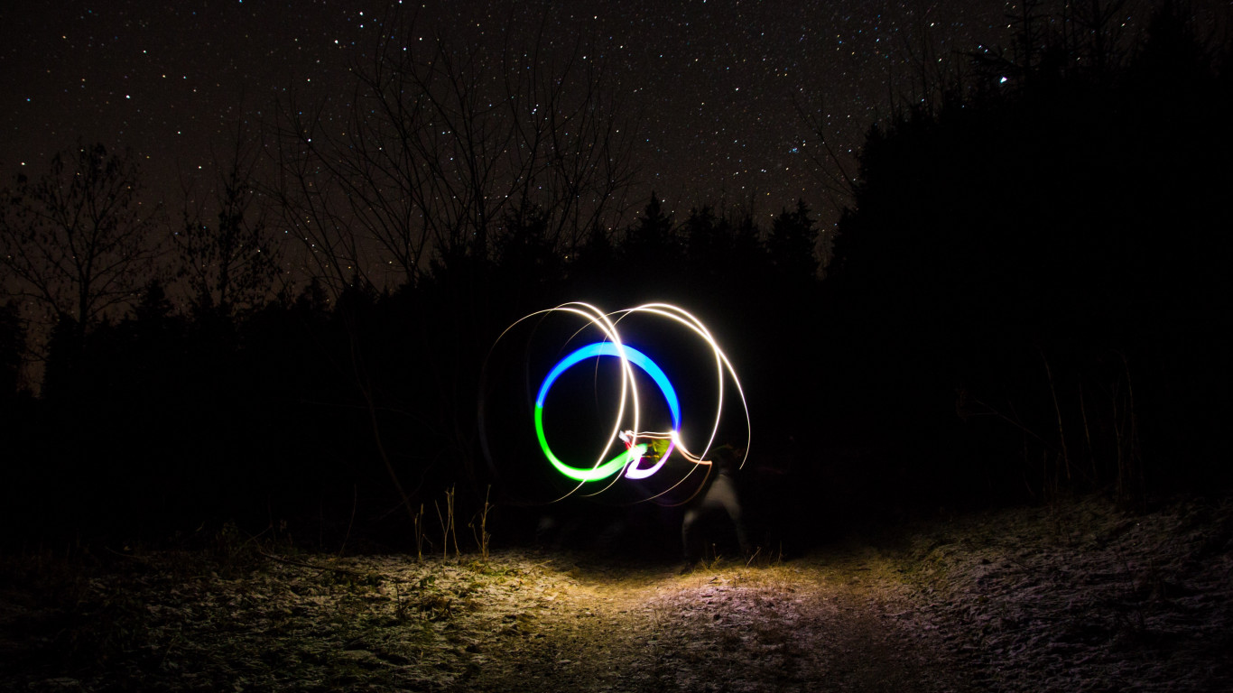 Light graffiti and the sky full of stars wallpaper 1366x768