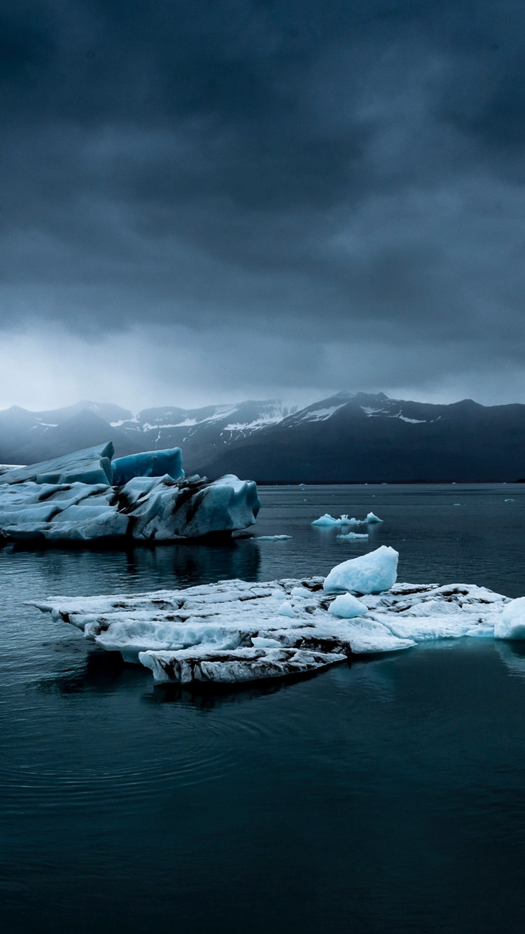 Icebergs, ocean in Iceland wallpaper 750x1334