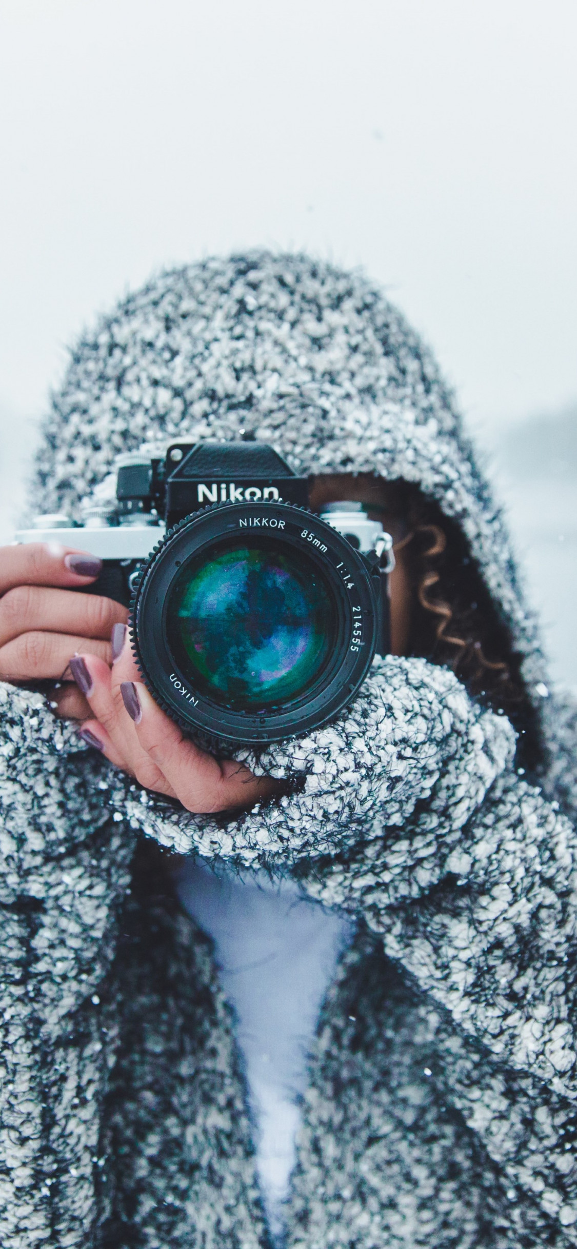 Photographer with Nikon camera | 1125x2436 wallpaper