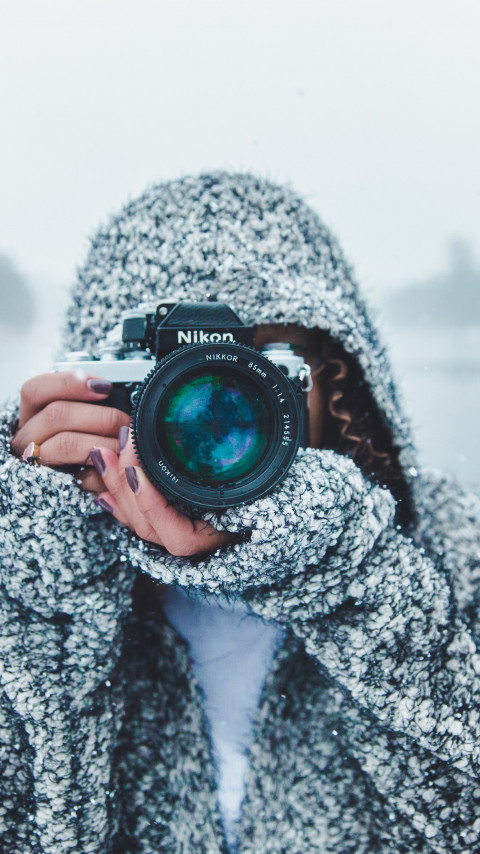 Photographer with Nikon camera wallpaper 480x854