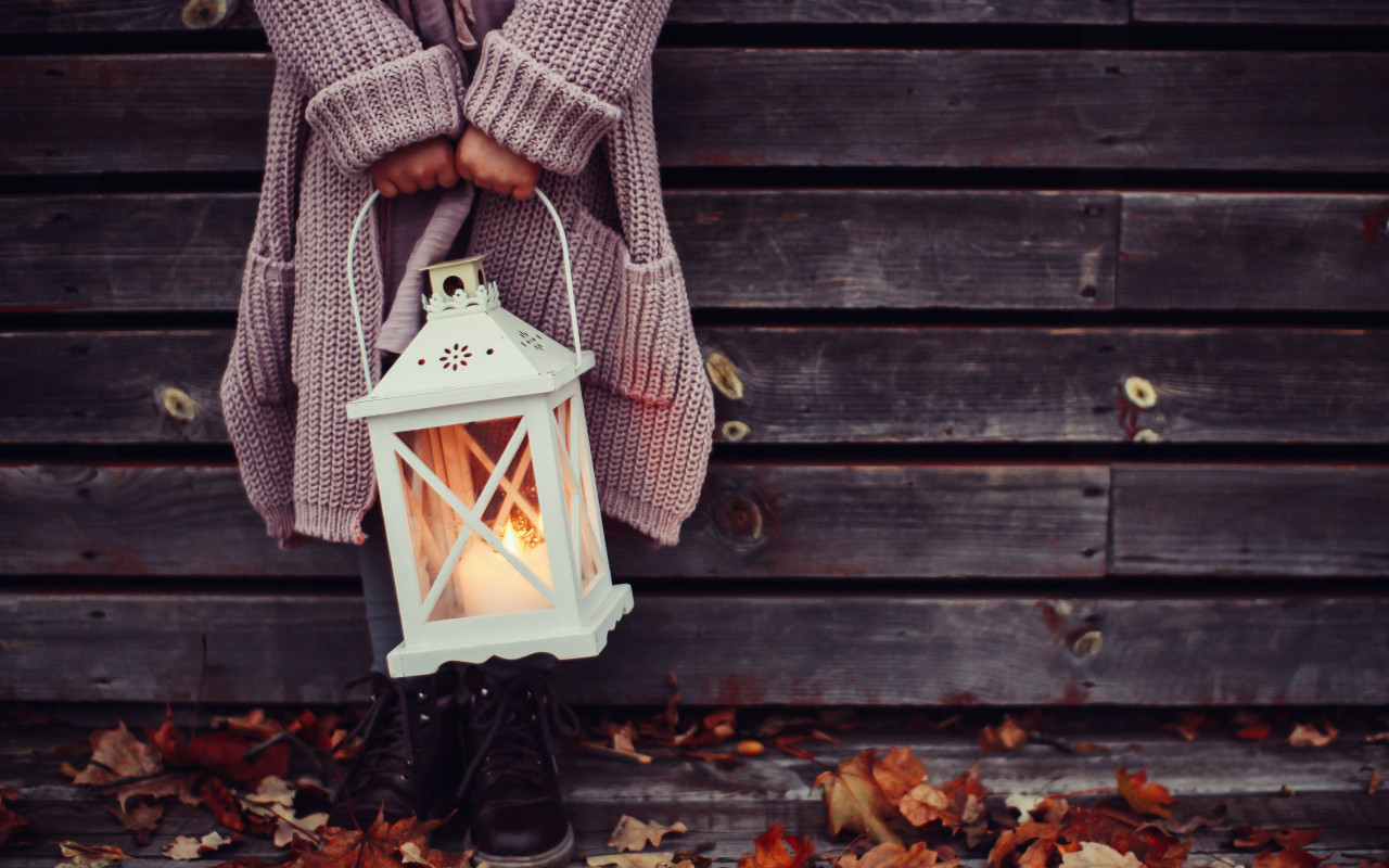 Autumn leaves and a child with lantern | 1280x800 wallpaper