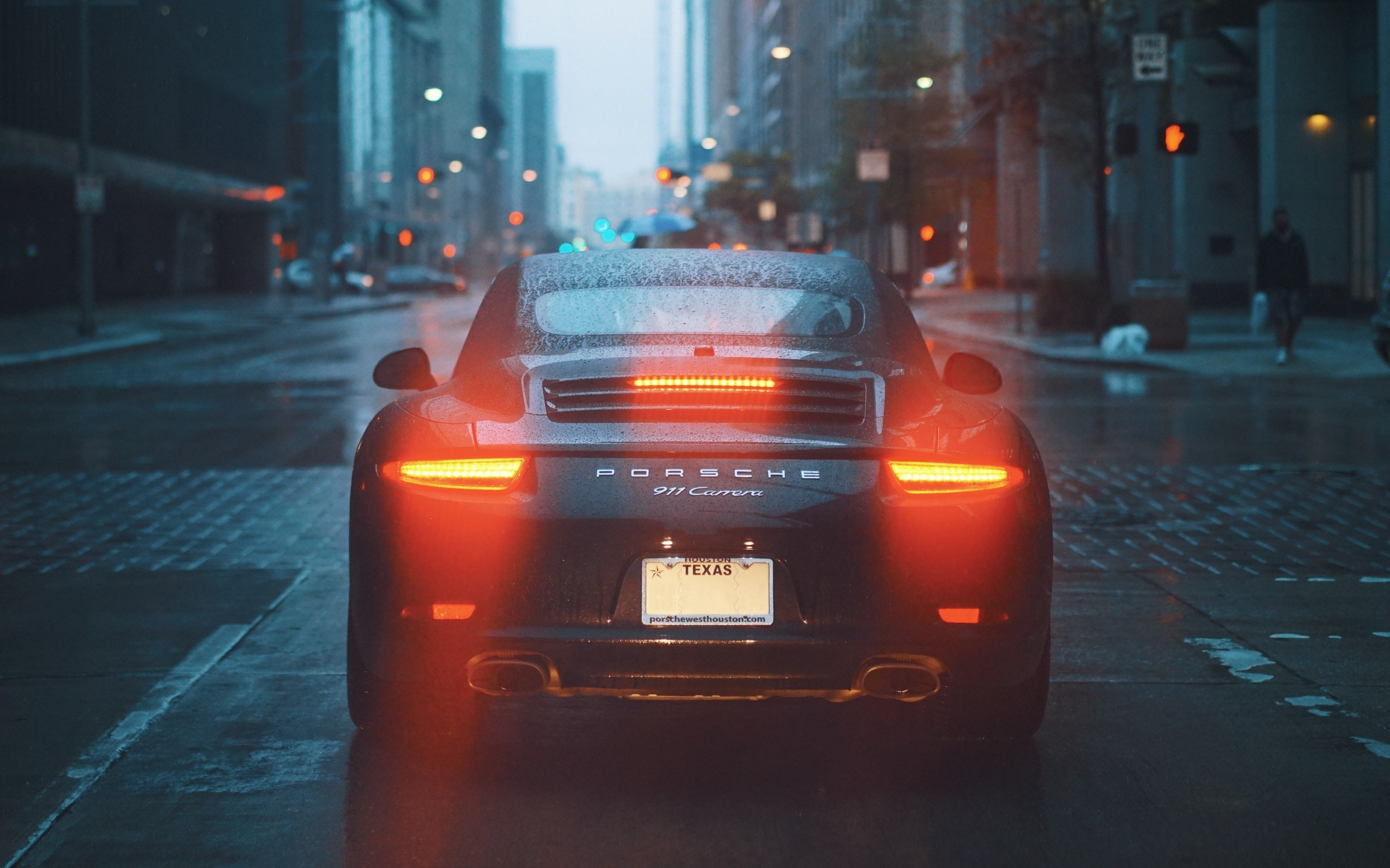 Porsche 911 Carrera on rainy streets wallpaper 2880x1800