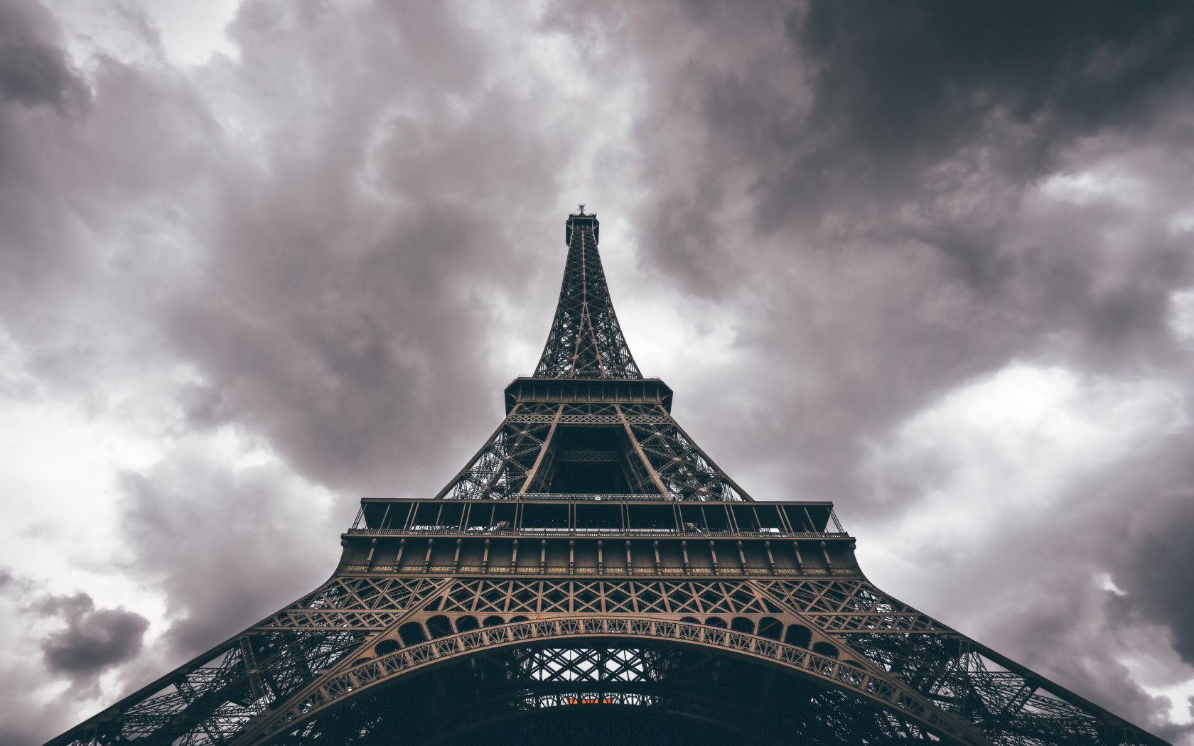 Eiffel Tower in a cloudy day wallpaper 1680x1050