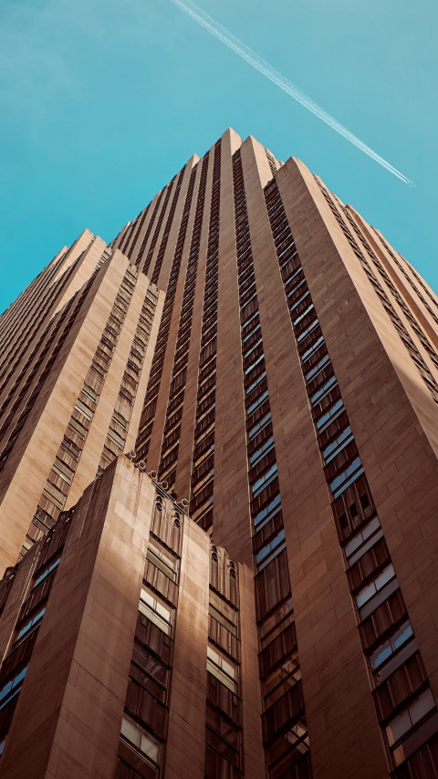 Rockefeller building touching the sky wallpaper 480x854