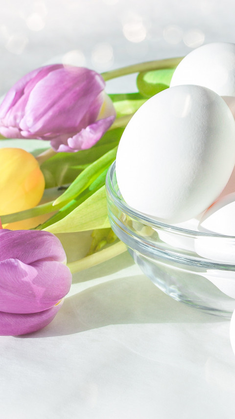 Easter eggs and beautiful tulips wallpaper 480x854