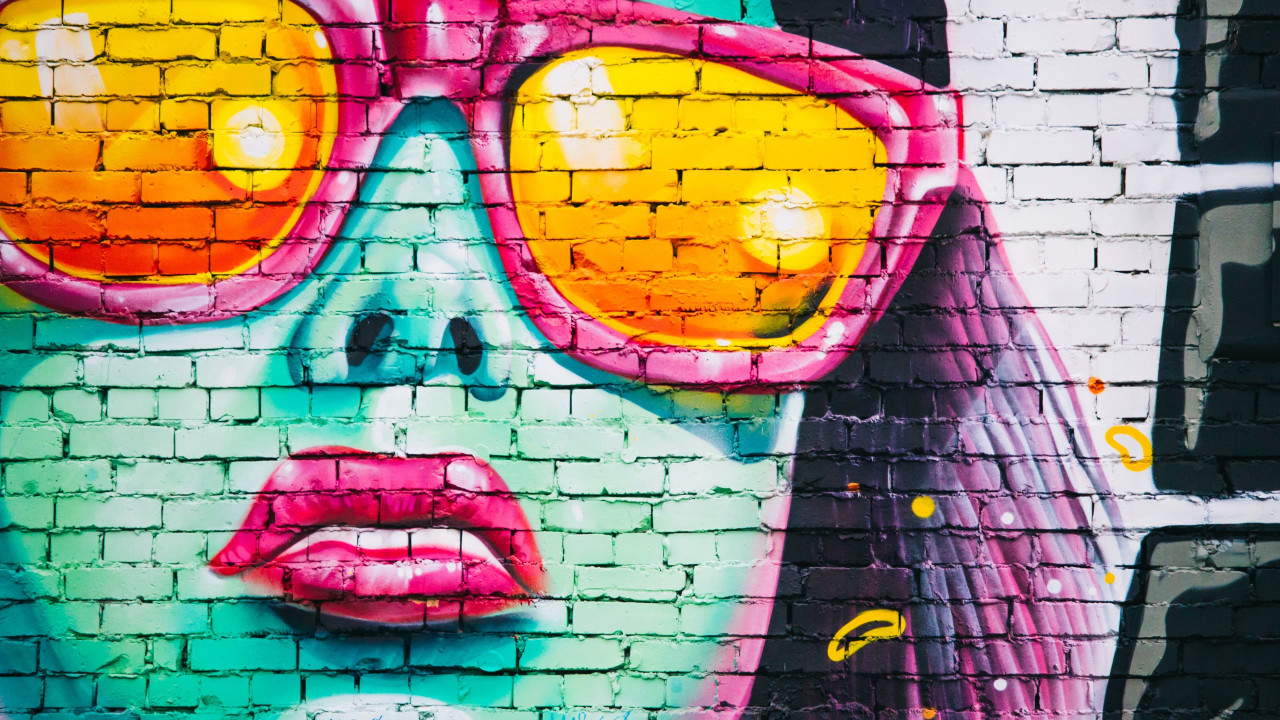 Wall graffiti with a girl portrait wallpaper 1280x720