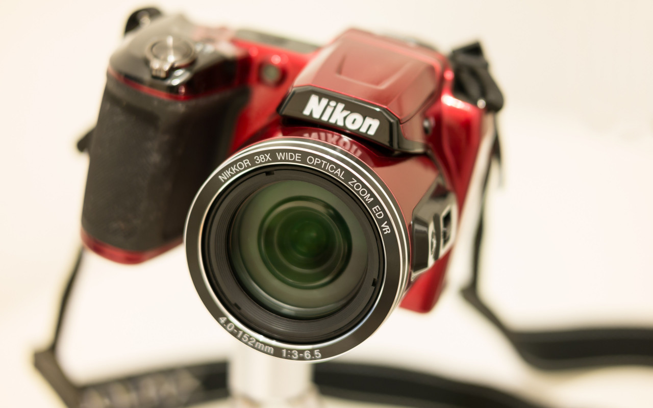 Nikon Camera with Nikkor lens wallpaper 1280x800