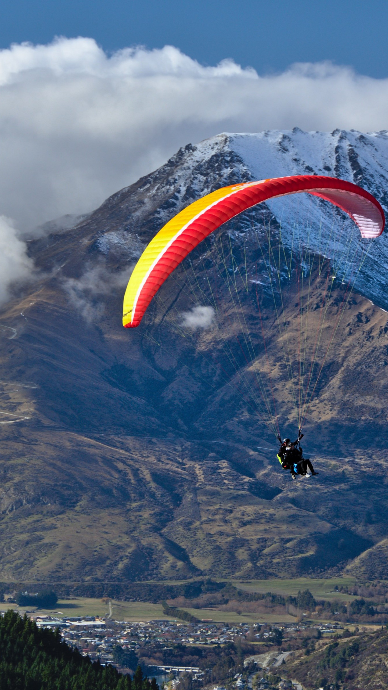 Paraglider up in the sky | 1242x2208 wallpaper