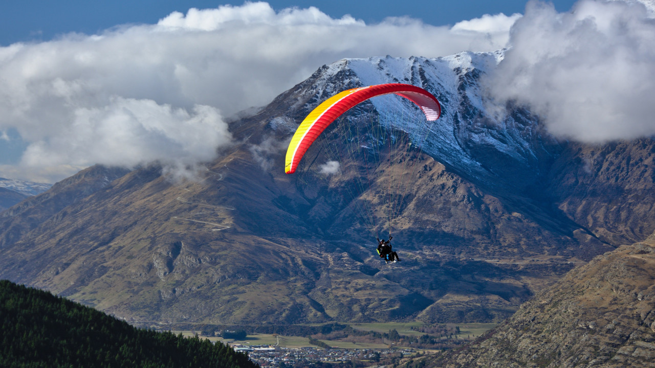 Paraglider up in the sky wallpaper 1280x720