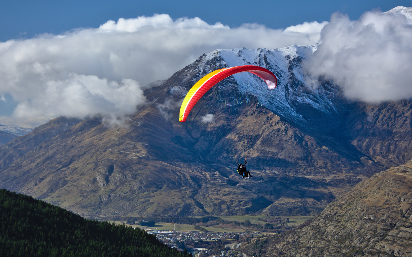 Paraglider up in the sky wallpaper 1680x1050