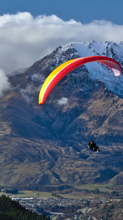 Paraglider up in the sky wallpaper 480x854