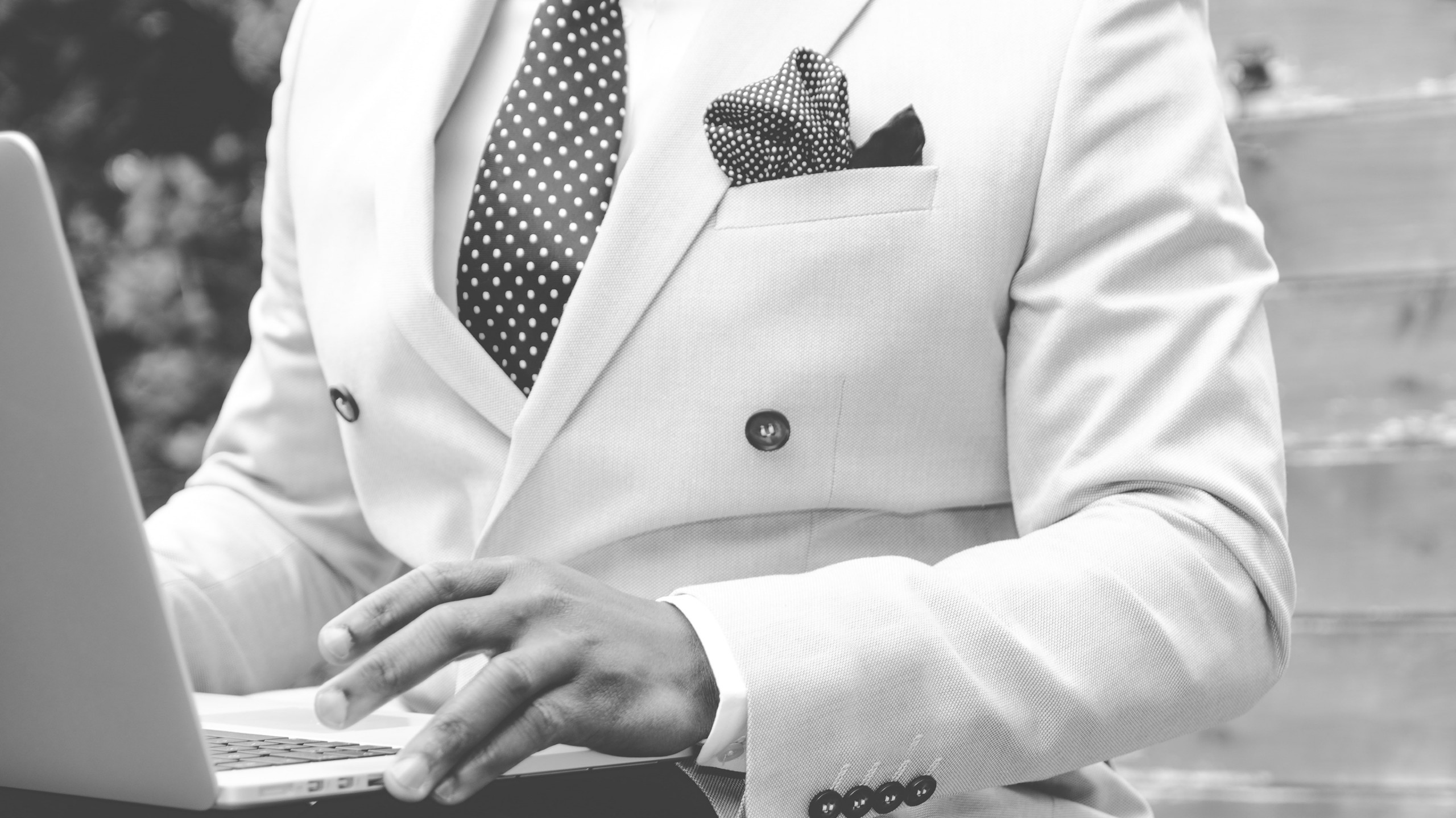 Download Wallpaper Stylish Man With His Laptop 2560x1440