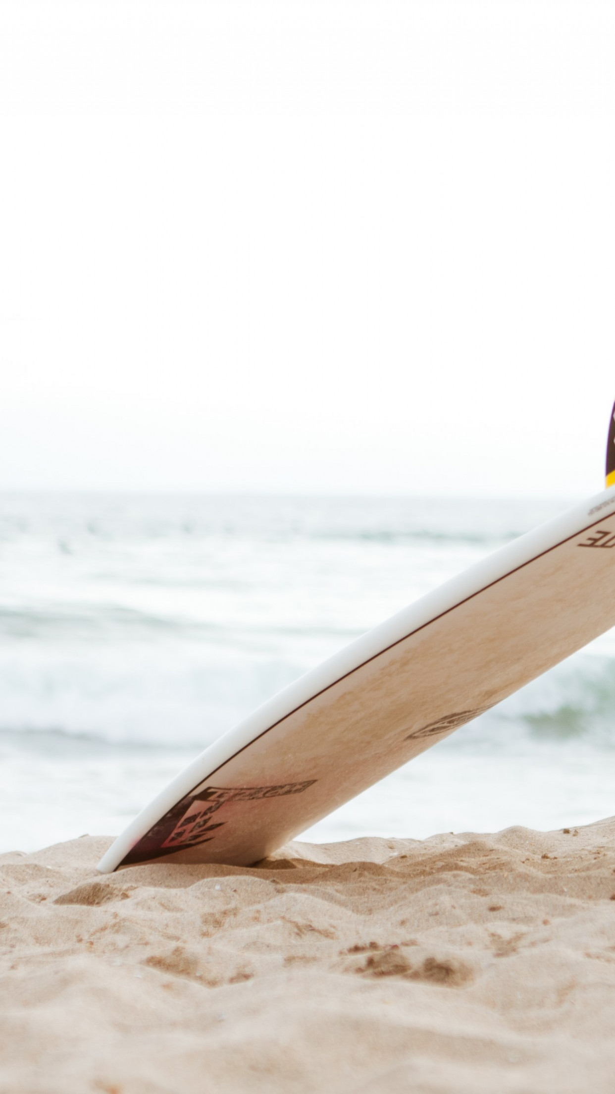 Surf board on the beach | 1242x2208 wallpaper