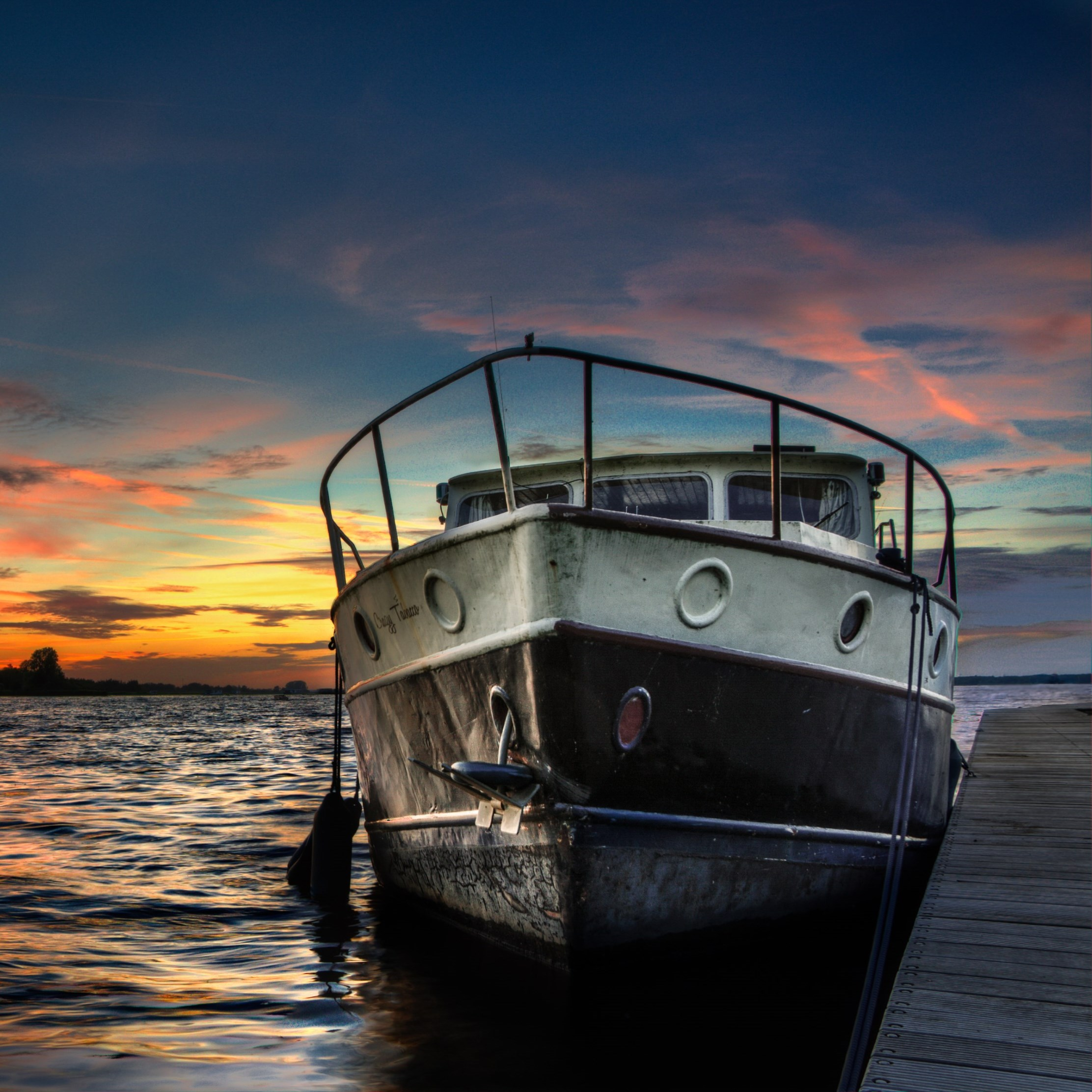 Boat and sunset in background | 2224x2224 wallpaper