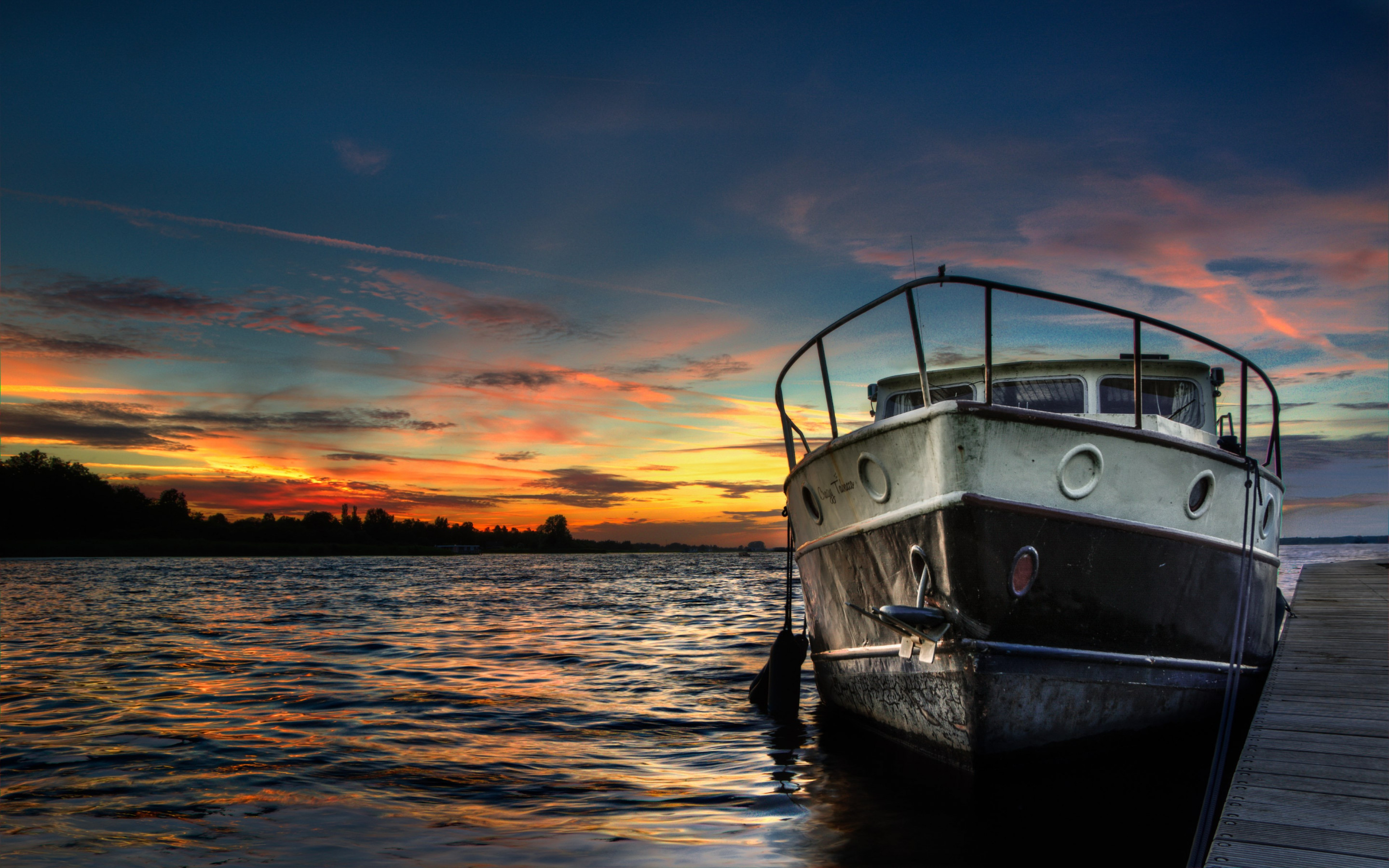 Boat and sunset in background | 2880x1800 wallpaper