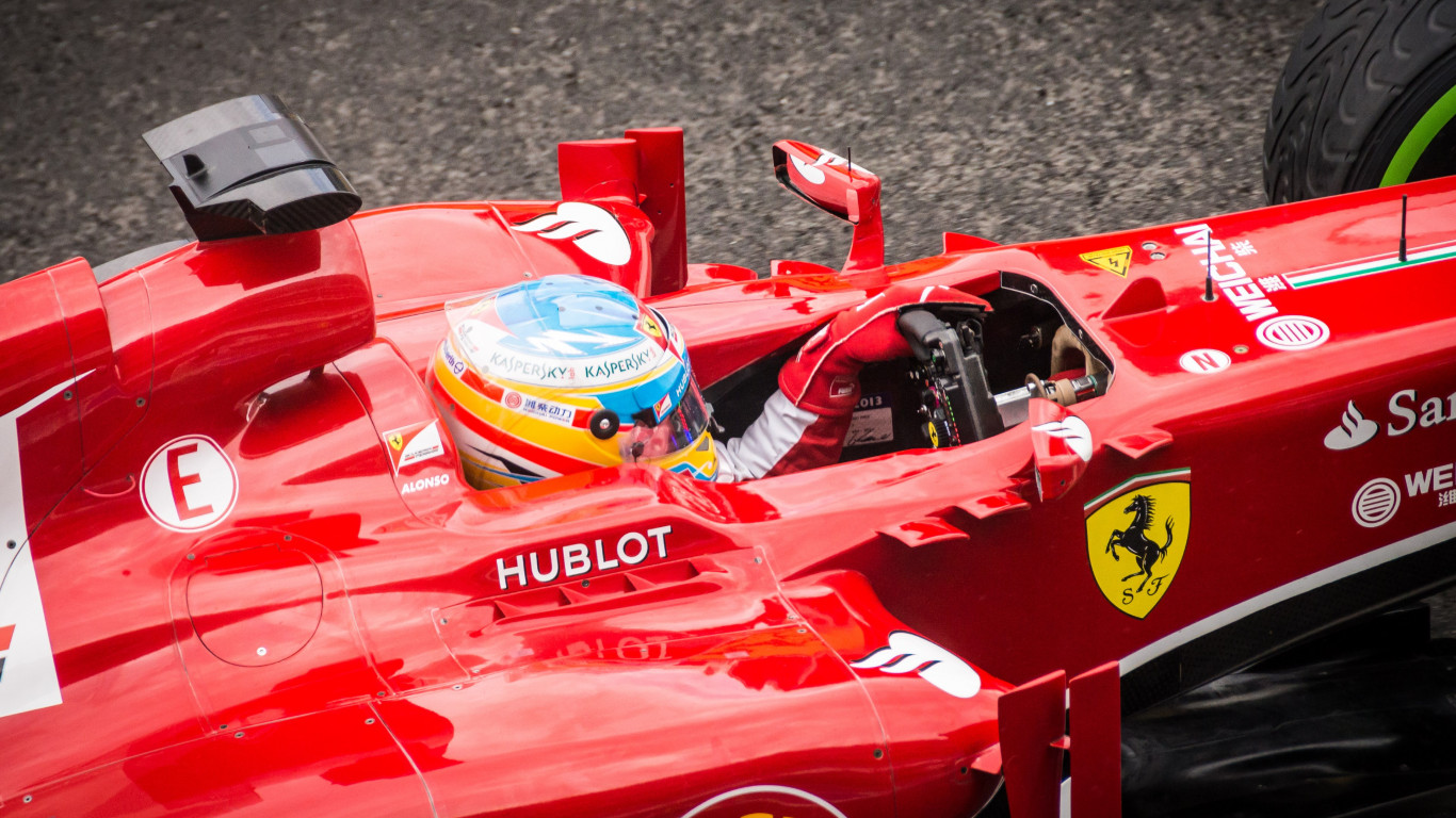 Alonso at Ferrari F1 Team wallpaper 1366x768