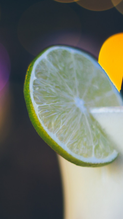 Exotic cocktail with lime wallpaper 480x854