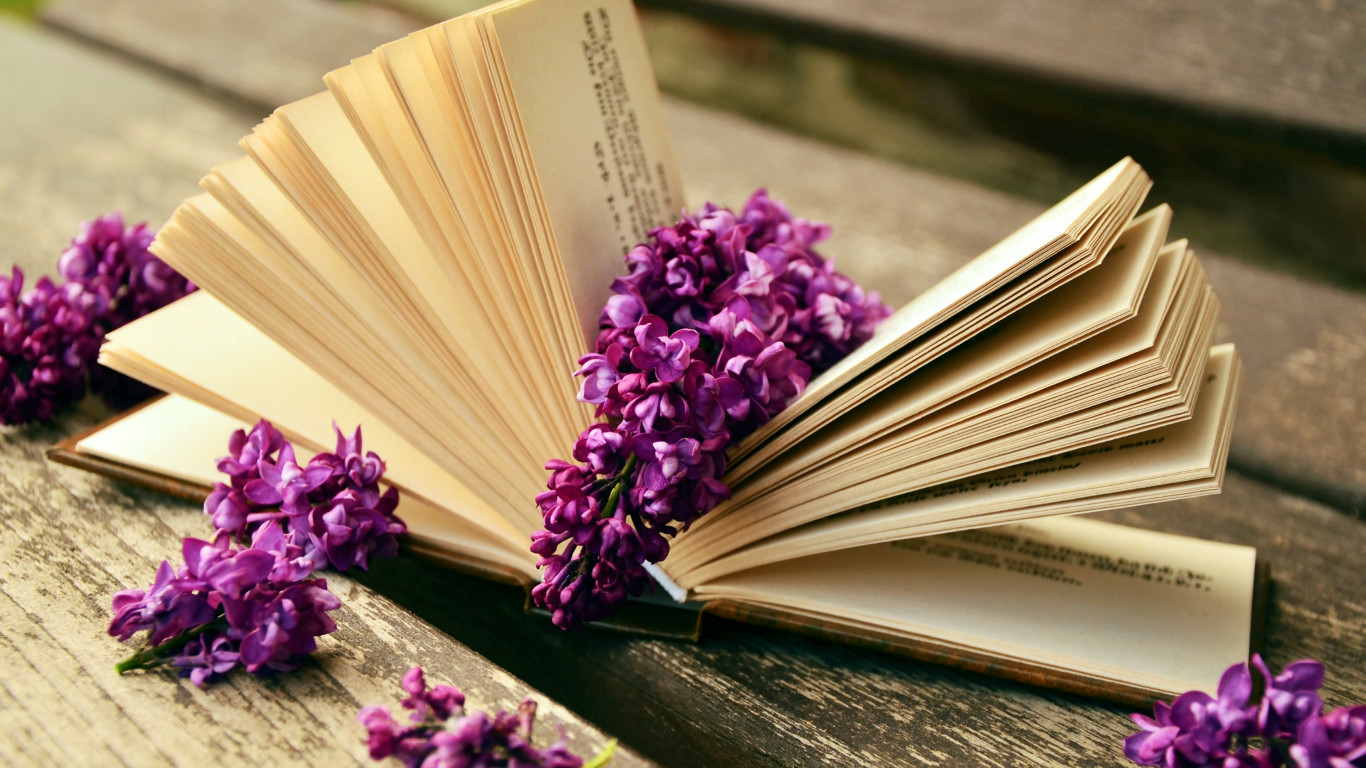 Lilac flowers and a good book wallpaper 1366x768