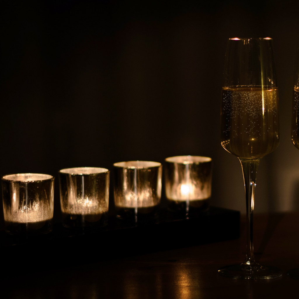 Champagne and candles wallpaper 1024x1024