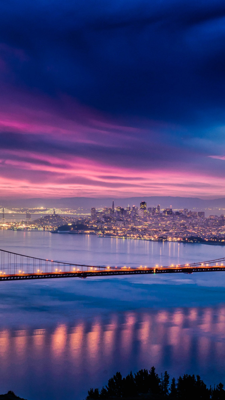 Skyfire over San Francisco Bay Bridge wallpaper 750x1334