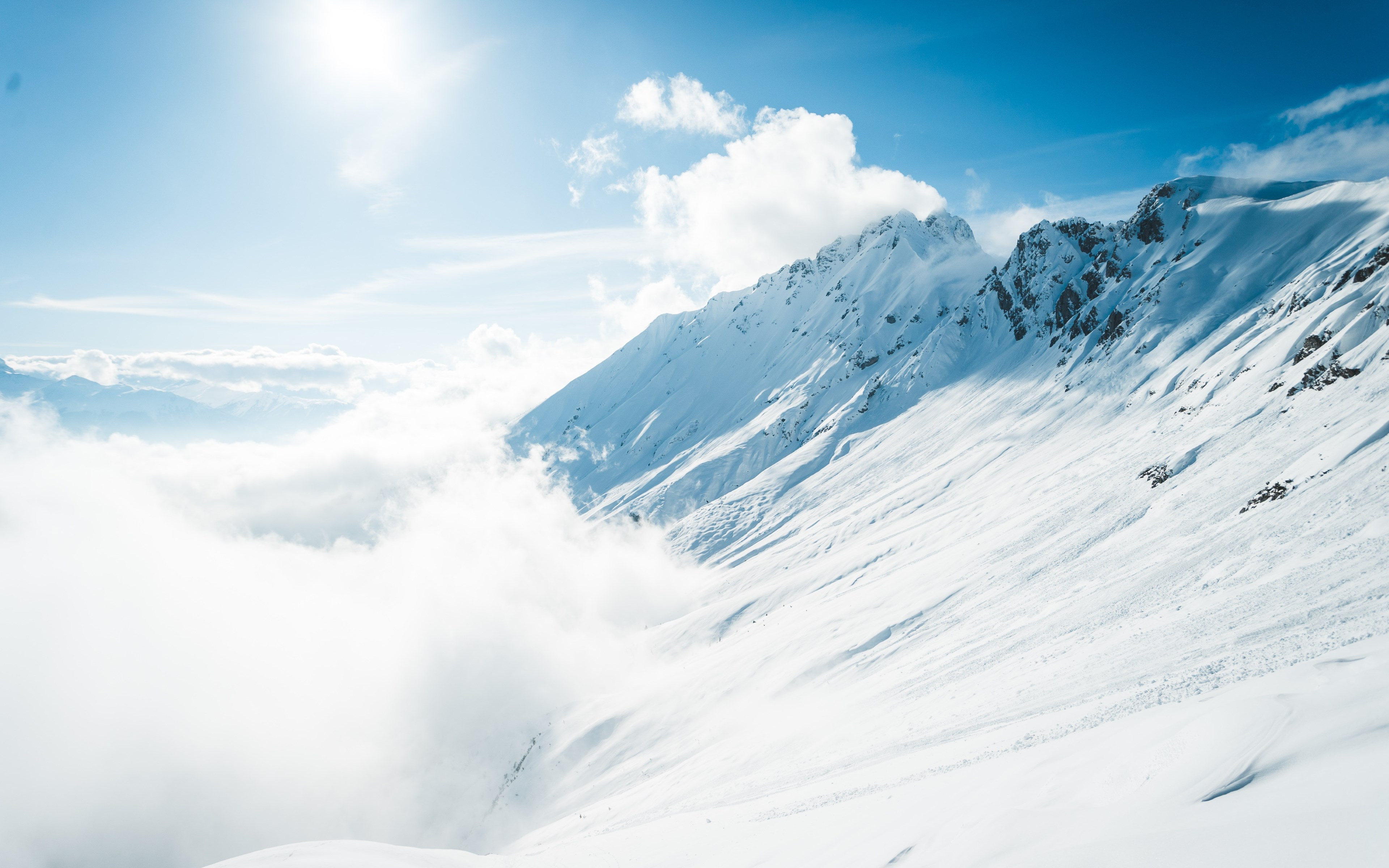 Mountains full of snow and blue sky wallpaper 3840x2400