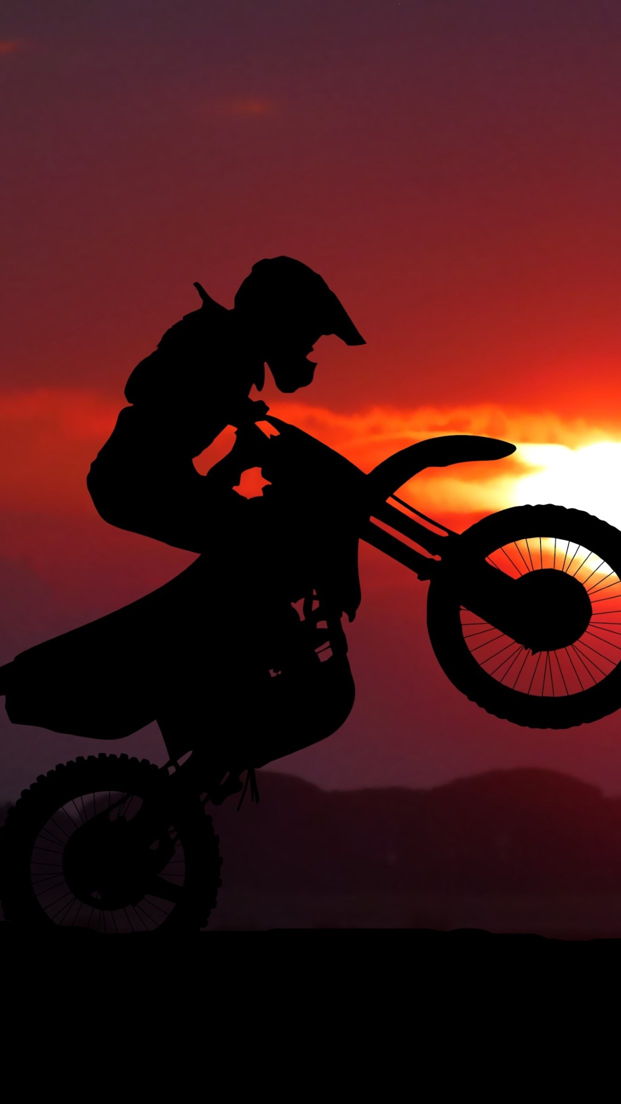 Biker on motorcycle at sunrise wallpaper 1242x2208