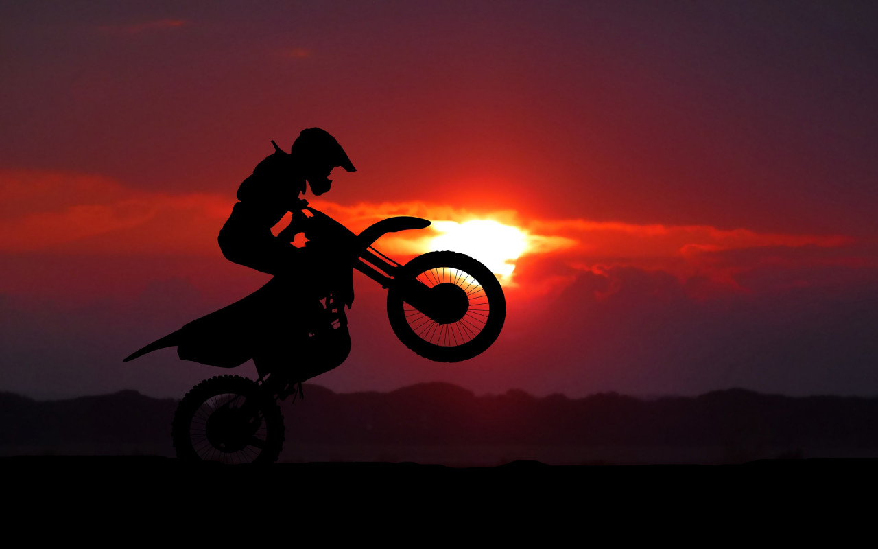 Biker on motorcycle at sunrise wallpaper 1280x800
