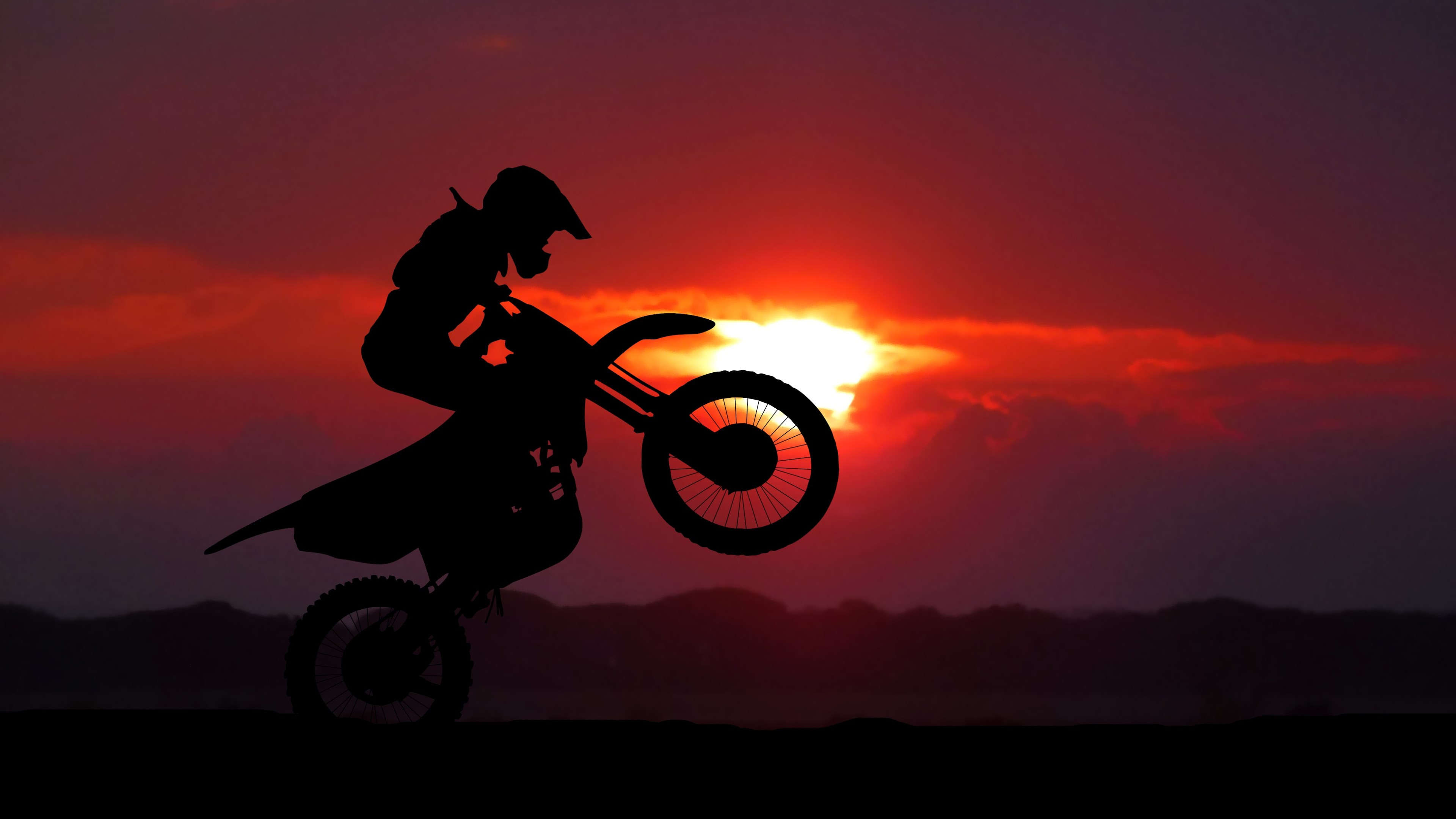 Biker on motorcycle at sunrise wallpaper 3840x2160
