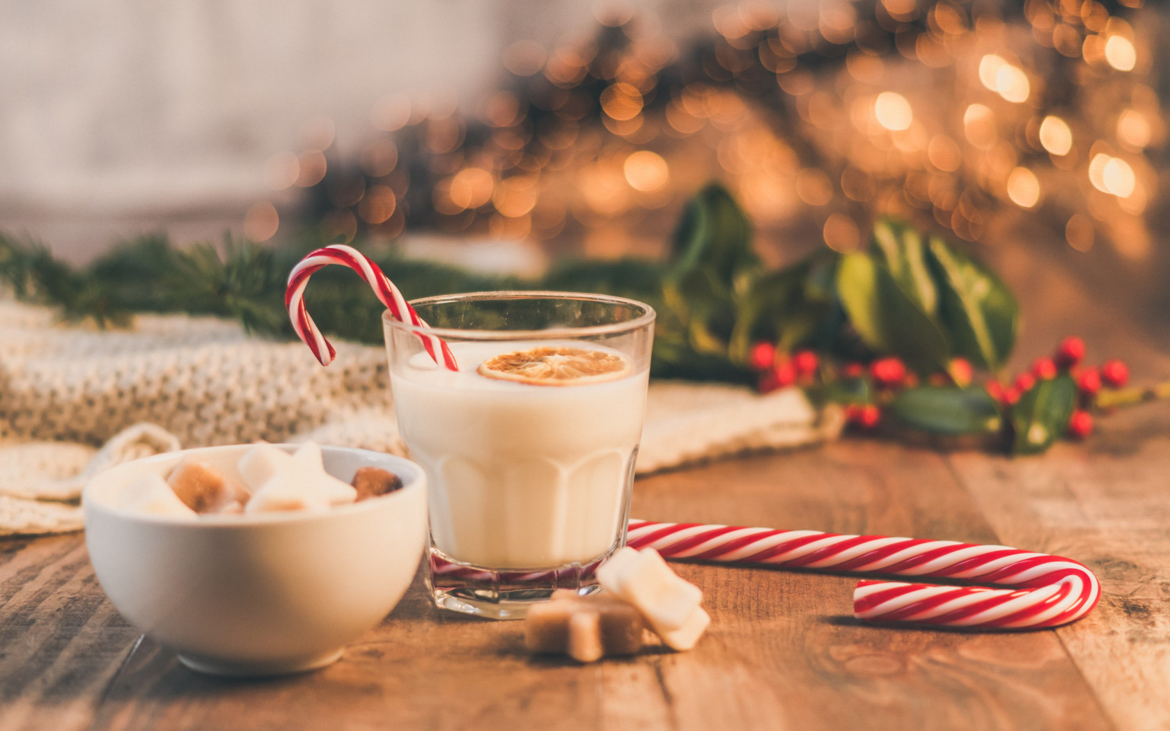 Seasonal Christmas sweets and cup of milk wallpaper 1680x1050