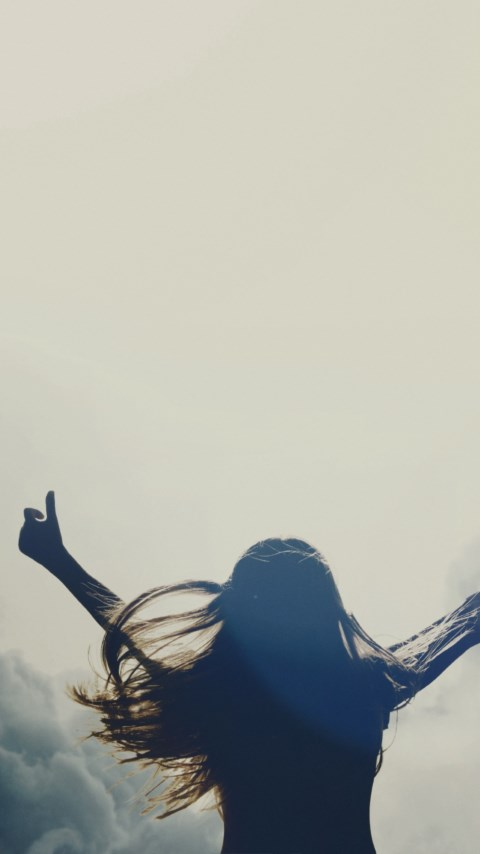 Girl silhouette above clouds wallpaper 480x854