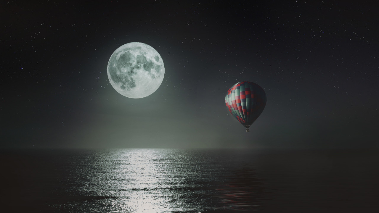 Hot air balloon over the night sky wallpaper 1280x720