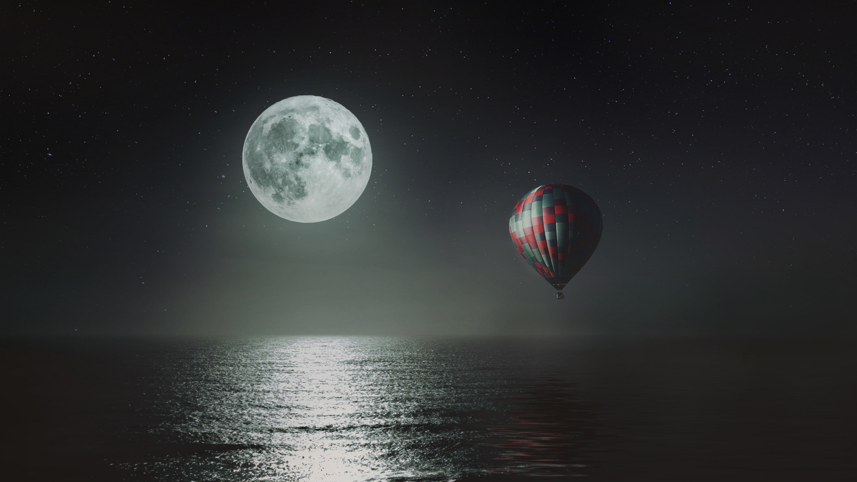 Hot air balloon over the night sky wallpaper 2880x1620