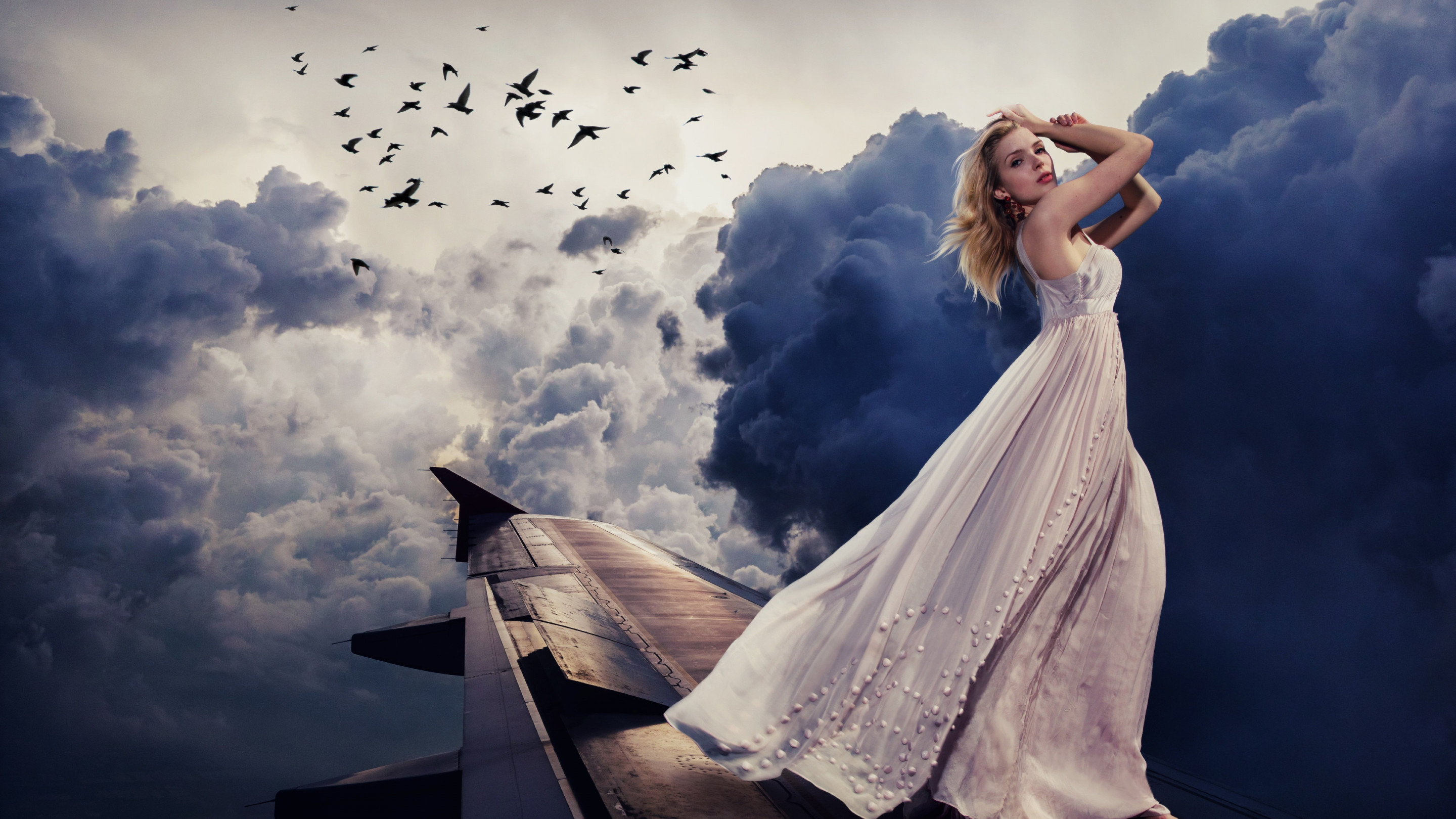 Beautiful girl on the airplane wing wallpaper 2880x1620